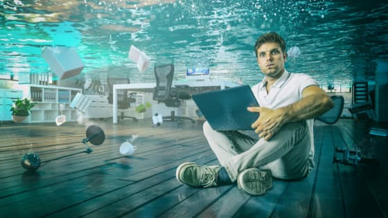 computers under water after flood depicting small business without disaster recovery plan