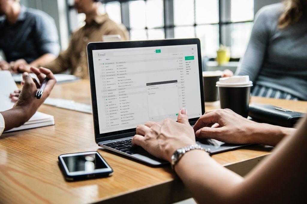 employee working on laptop in meeting