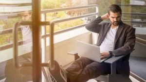 small business owner managing own IT on laptop