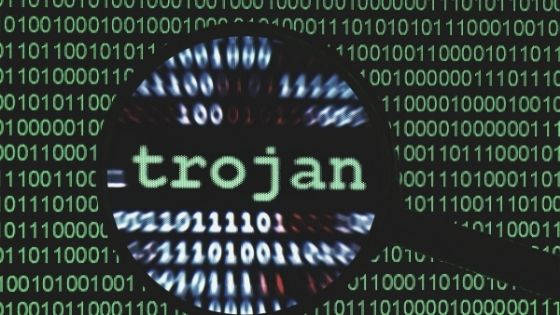 Concept art of trojan virus on computer code