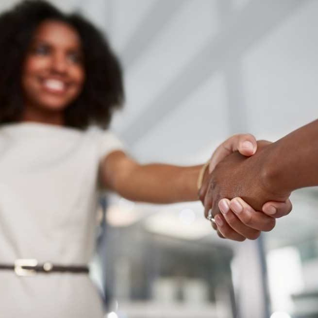 woman winning business service agreement and shaking hands